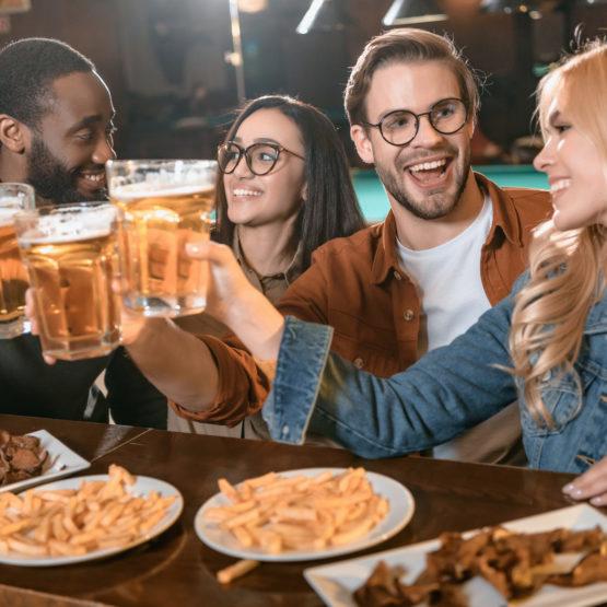 Frienda Drinking at a Bar at night